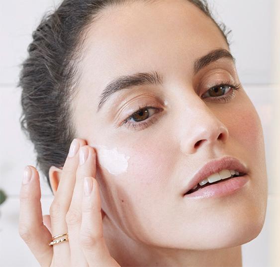 Woman moisturisingher face