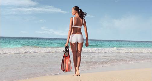 Model walking on beach